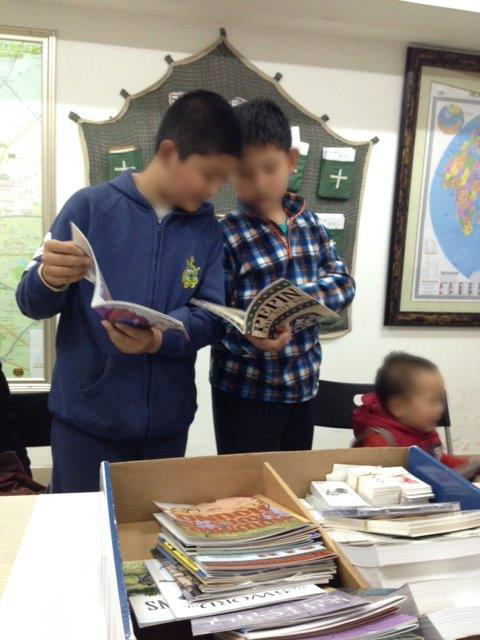 Chinese students reviewing Christian education materials